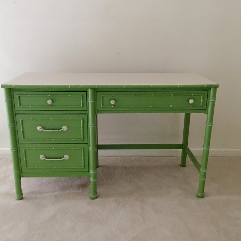 Thomasville Allegro faux bamboo desk in original preppy pistachio green with white striated formica top and four drawers.