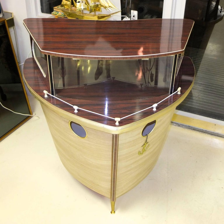 1950s standing cocktail bar by Umberto Mascagni of Bologna, Italy and imported to the UK (later, possibly produced by) by I. Barget Ltd. then retailed through Harrod's.   Cocktail bar in the form of the bow of a cabin cruiser on three tapered