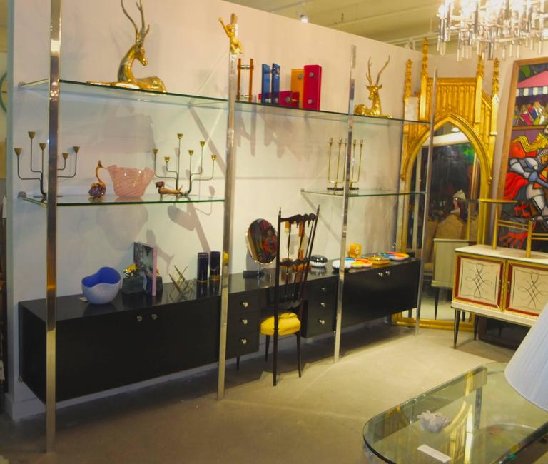 SATURDAY SALE   This is an original early 1970s Pace Collection three bay wall shelves with wall-mounted cabinets and desk or vanity.  Four mirror polished aluminum uprights hold three cases and five glass shelves.  Cases are divided and have