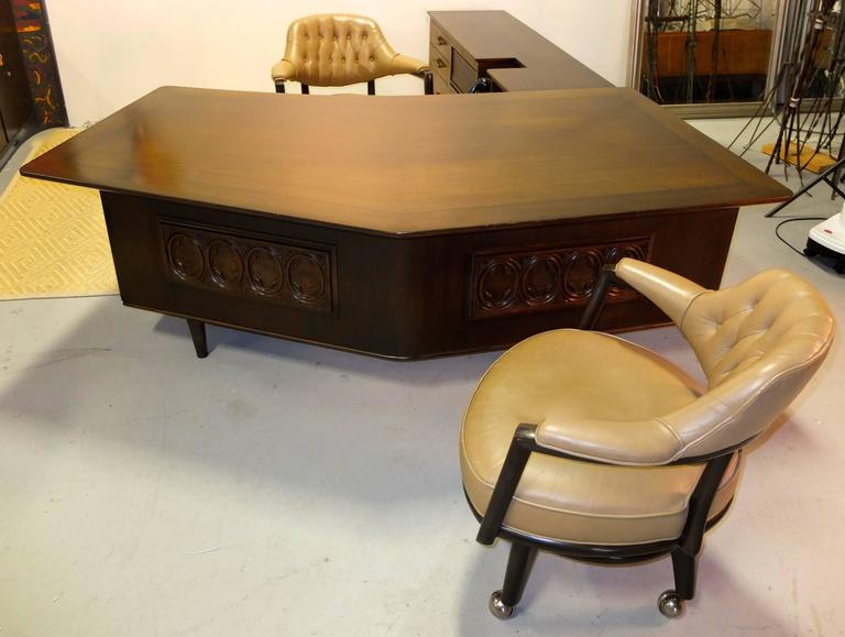 Maurice Bailey designed this executive office suit, circa 1959 for Monteverdi-Young. We acquired it directly from the original owner, a retired lawyer in Beverly Hills, CA.  Stylish stealth bomber walnut desk with off centered peaked table top in