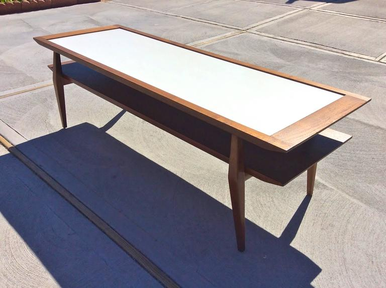 Two-tier coffee table in walnut with white Micarta top designed by Bertha Schaefer for M. Singer & Son's.
