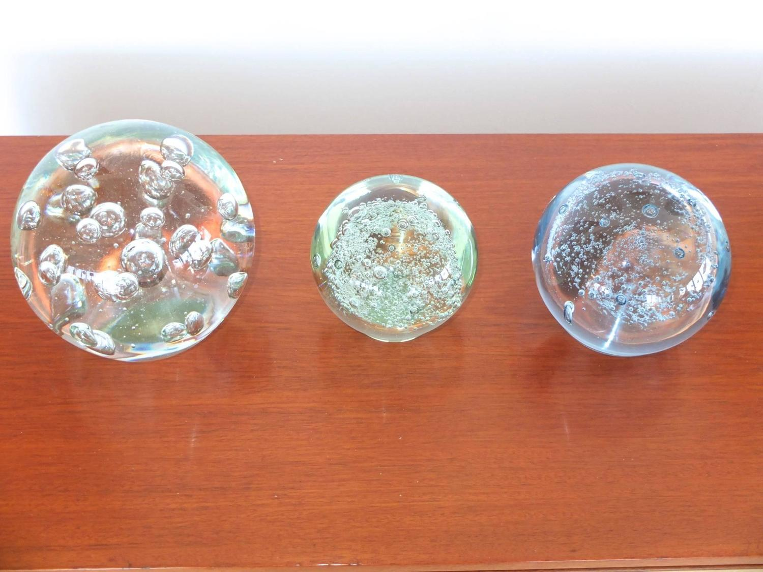Vintage glass ball paperweights with controlled bubble