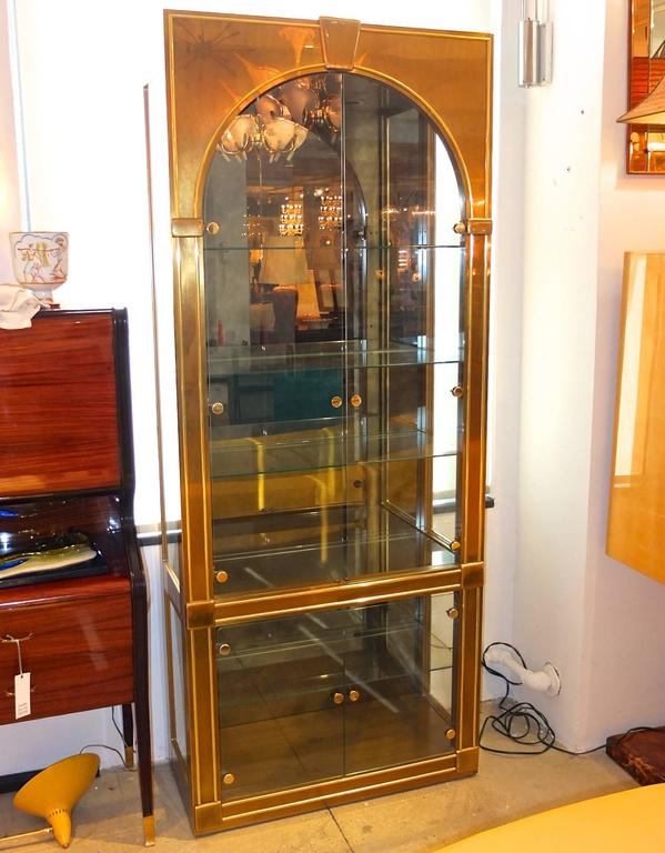 SATURDAY SALE  Vintage 1970s Palladian style brass, glass and antiqued smoked mirror vitrine display cabinet by Mastercraft (label inside). Measures: 85 in. H x 34 in. W x 16 in. D. Five clear glass removable shelves. Interior light.