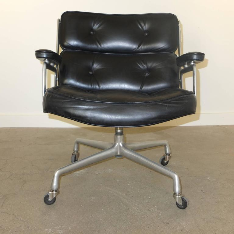 Original 1960s model of Eames' Lobby chair for the Time Life building designed by Herman Miller. Original black leather has been cleaned and conditioned by Hub Leather. Early wheels without fenders (can be removed if preferred). This is the shorter