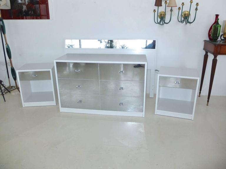 Produced in 1963 for Charak modern, a clean bedroom set with Pierre Cardin glam. Crisp white painted wood cases with mirror faced drawer fronts and headboard. Freshly repainted by professional cabinet finishers. Set consists of a Full size