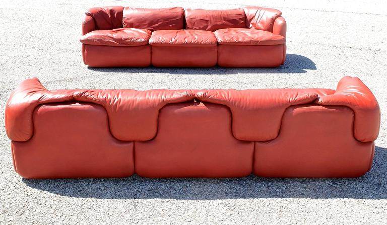 Pair of leather sofasand matching armchair.  An important pair of leather three-seat sofas and lounge chair designed by the Italian architect, Alberto Rosselli in 1972 for Saporiti Italia. The