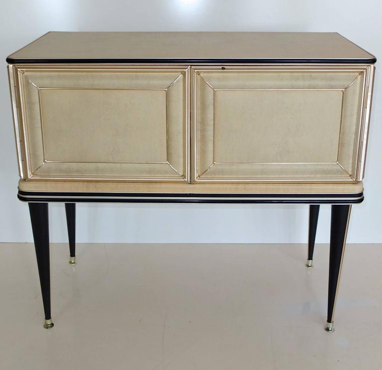 Early 1950s sideboard bar cabinet created by Umberto Mascagni of Bologna, Italy, imported to the UK by I. Barget and retailed through Harrod's, London, 1952-1955. Mascagni was known for his provocative use of new materials in furniture designs such