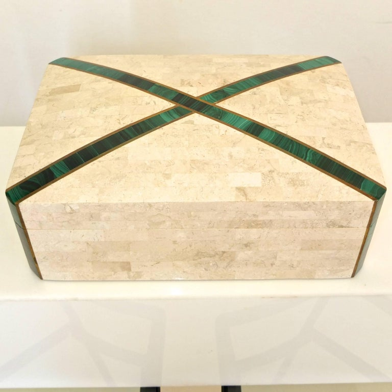 Two in one. Large hinged lidded box with brass inlay and what appears to be malachite. Wood lined. Suitable for use as a humidor or jewelry box.