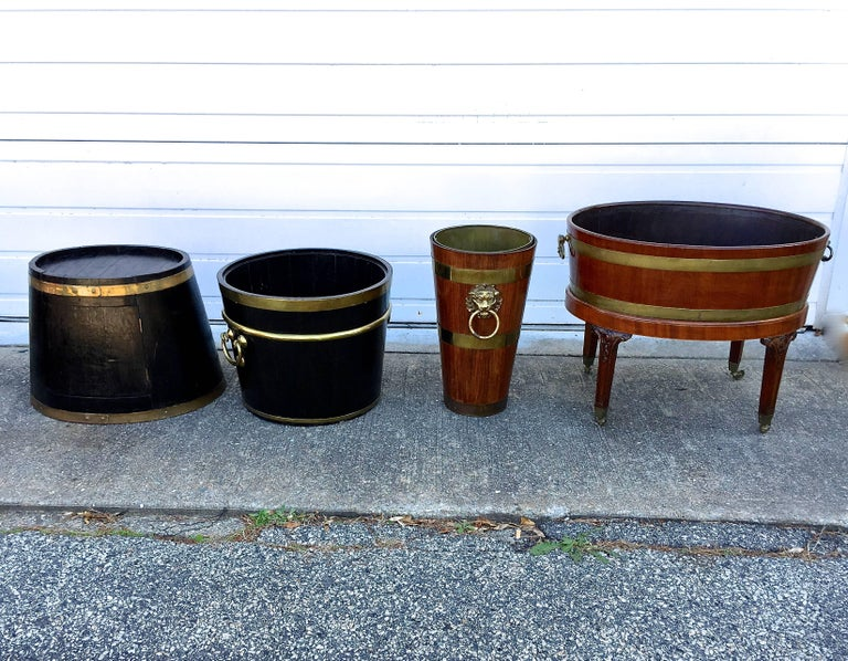 Fantastic grouping of antique mahogany and oak plate buckets, wine bottle coolers, umbrella holders, flower buckets, what ever you want to use them for.  Even for holding kindling, as plant stands or where to toss the Sunday papers.  Gorgeous hefty