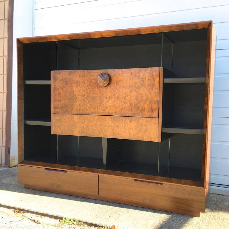 Gilbert Rohde large-scale bookcase with drop-front secretary desk and storage drawers in exotic burl paldao wood from his 1941 Paldao Collection for Herman Miller. 