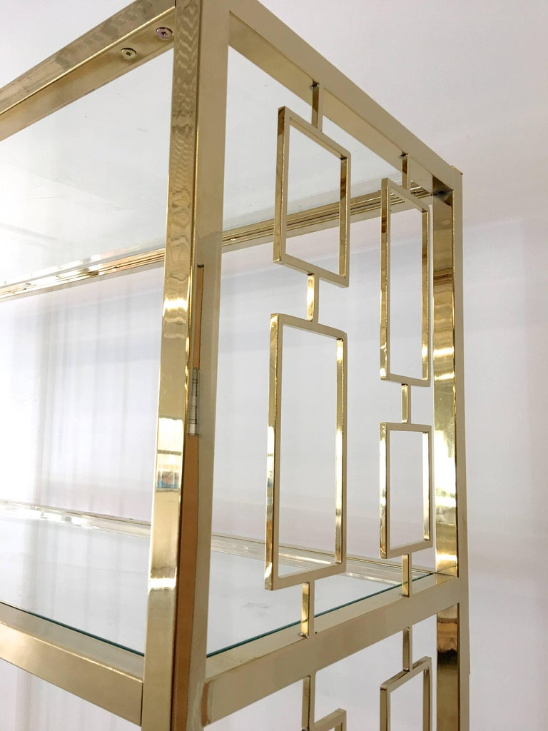 Nine Hollywood Regency Brass & Glass Geometric Etageres In Excellent Condition For Sale In Hingham, MA