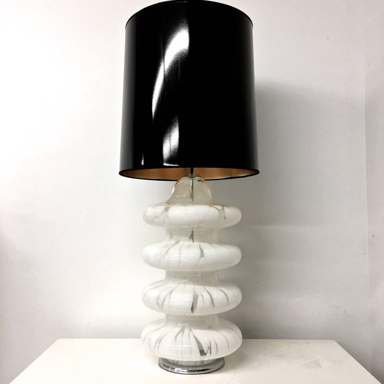 Four-tier pagoda form table lamp by Carlo Nason of Mazzega consisting of handblown Murano glass with white swirls amidst clear glass having a tortoiseshell effect. Nickel plated round base and lamping which include two standard size Edison screw