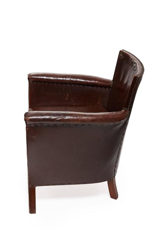 20th century Otto Schultz Swedish Leather Armchair.  Original Leather /Nail Heads which are in great vintage condition  Seat cushion is newly reupholstered in matching leather