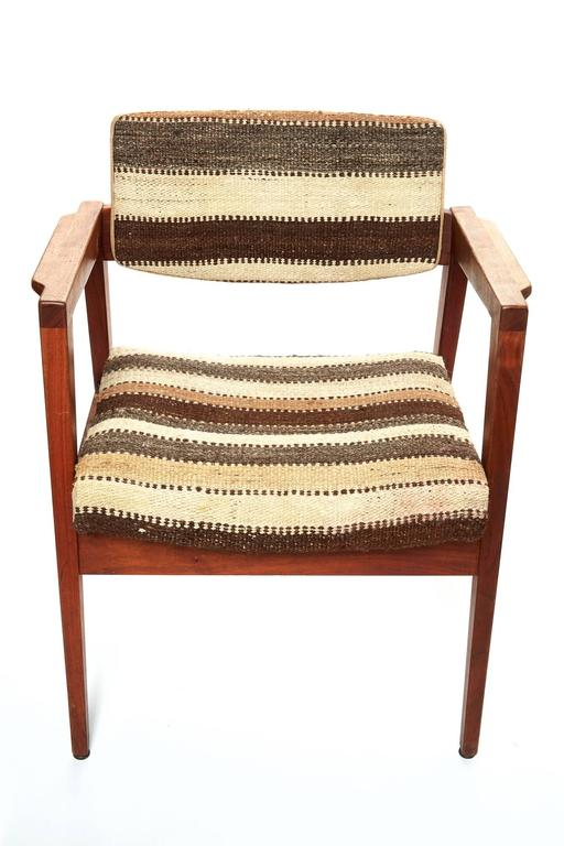 Pair of mid-20th century  Danish armchairs.  Covered in vintage African Berber rug.  Structure is very stabile and chairs have been restored and reupholstered.