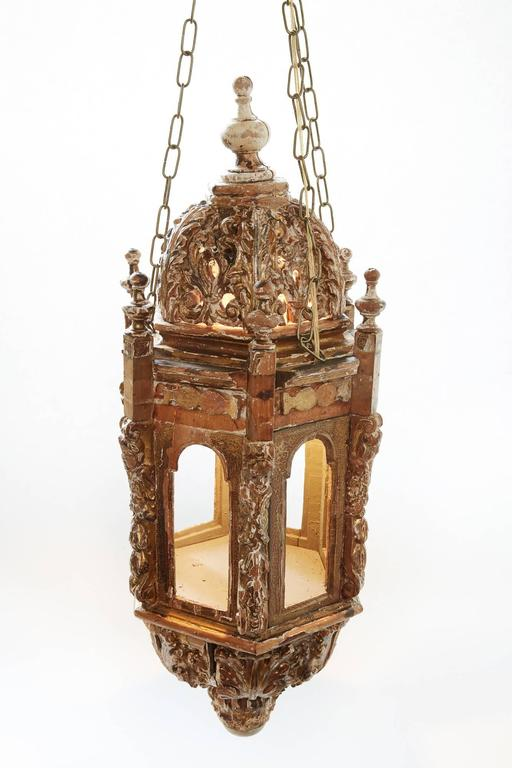 Pair of 18th century Italian Giltwood Lanterns found in England The details of the lanterns reflects the period of fabrication. The remaining gilt is evident but not prevalent. The pieces were originally candle lit lanterns on posts which were held