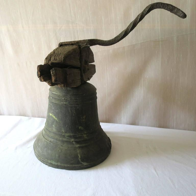 French Provincial Property Bronze Airin Bell Dated 1815 with its Wrought Iron Top and Wood Beam For Sale