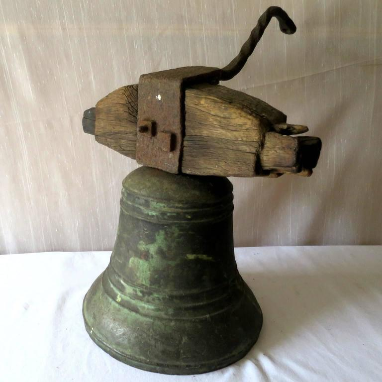 Cast Property Bronze Airin Bell Dated 1815 with its Wrought Iron Top and Wood Beam For Sale