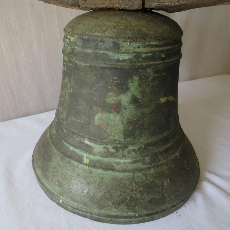 Property Bronze Airin Bell Dated 1815 with its Wrought Iron Top and Wood Beam In Good Condition For Sale In Miami, FL