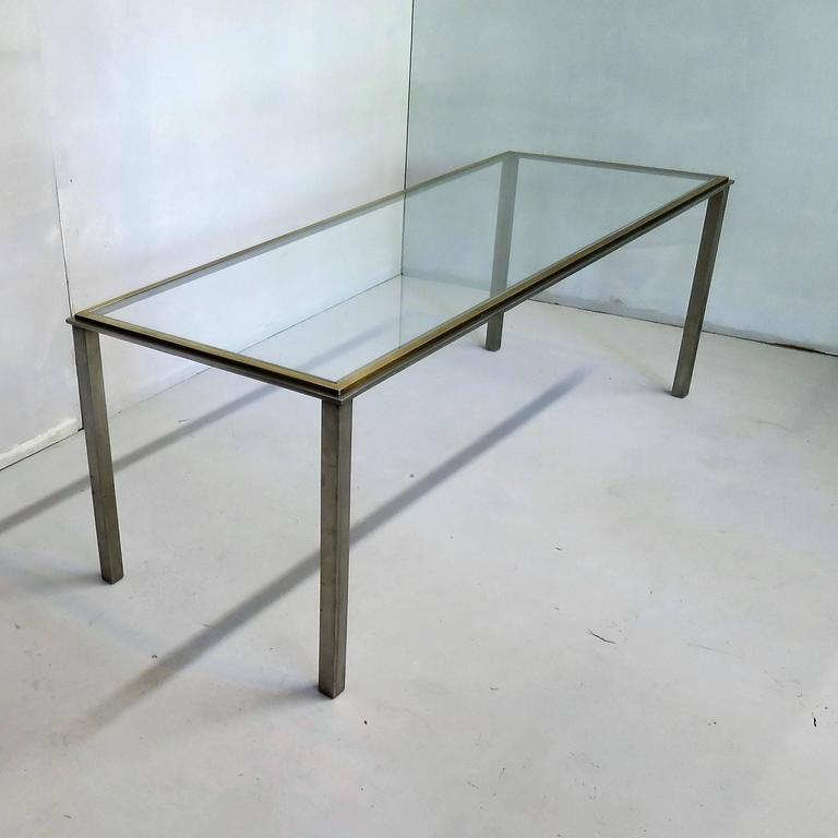Very interesting design, sober lines in steel and brass, glass top. Romeo Rega style.