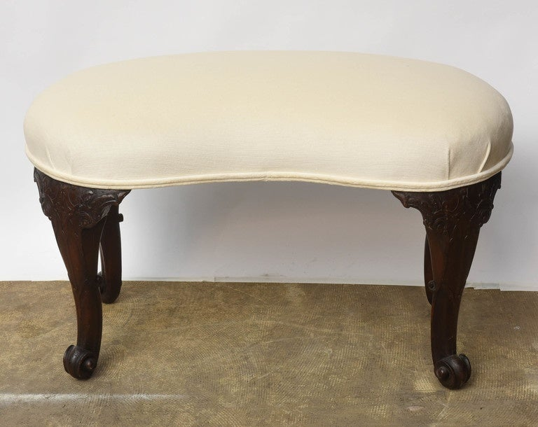 Elegant and refined piece,Kidney shaped seat , recently reupholstered in ivory fabric. Perfect for a woman dresser seat.  Very finely carved legs, kidney shaped seat. Ottoman seat .