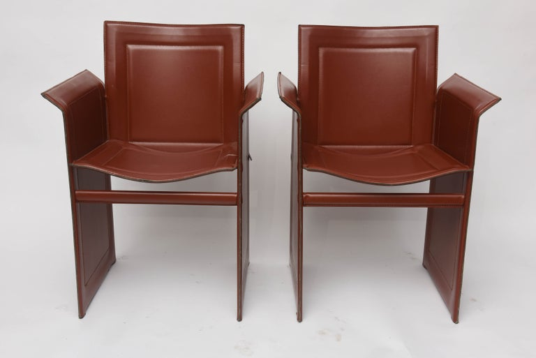 Four Mid-Century Modern leather Matteo Grassi pair of armchairs. Exceptional armchairs in Cognac leather.  Very comfortable around a dining table (a set of four is available).