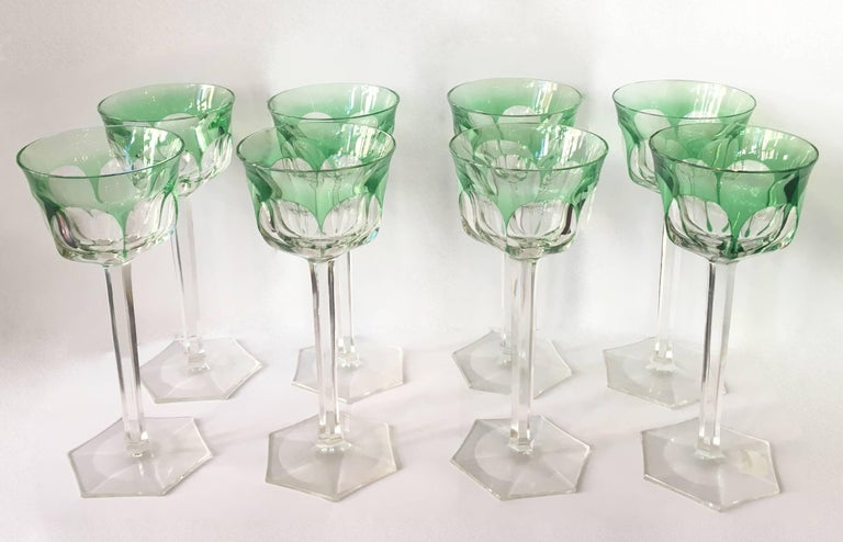 Beautiful set of eight tall stemmed green wine glasses by Belgium glass maker Val Saint Lambert. The Osram pattern adds unique style and detail.