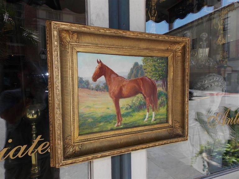 American oil on board portrait of horse landscape in the original gold gilt floral frame. Signed James Weiland, (1872-1968) New York, Early 20th century.  Weiland studied at the Royal Academy in Munich, Colarossi in Paris, the Art Students league