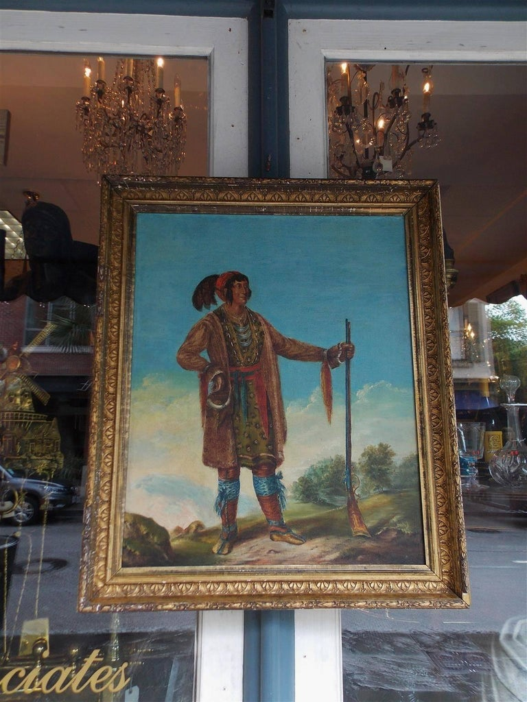American oil on canvas portrait of Osceola standing with Musket in the original gilt floral frame. Landscape in background, Late 19th century  Osceola was a Seminole war chief who led the resistance to the Campaign by U.S. Federal troops to forcibly