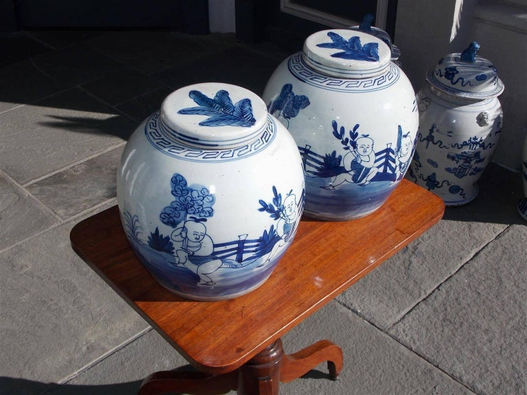 Pair of Chinese Porcelain Glazed Figural Ginger Jars with Lids, 20th Century In Excellent Condition For Sale In Charleston, SC