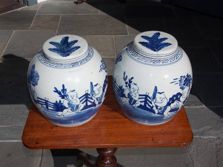 Chinese Export Pair of Chinese Porcelain Glazed Figural Ginger Jars with Lids, 20th Century For Sale