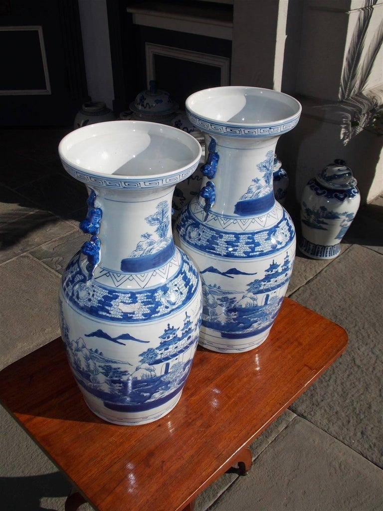 Chinese Export Pair of Chinese Porcelain Glazed Foo Dog and Pagoda Temple Jars, 20th Century For Sale