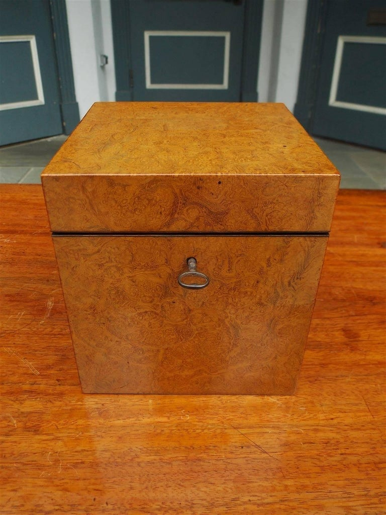 Chinese burl walnut hinged tea caddy with the original five decorative floral Pewter bins with lids. Tea Caddy retains the original lock and key. Bins are signed by maker, Early 19th Century.