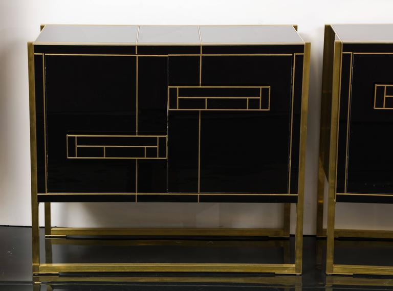 Mid-Century Modern One of a Kind Signed Pair of Black Glass and Brass Cabinets For Sale