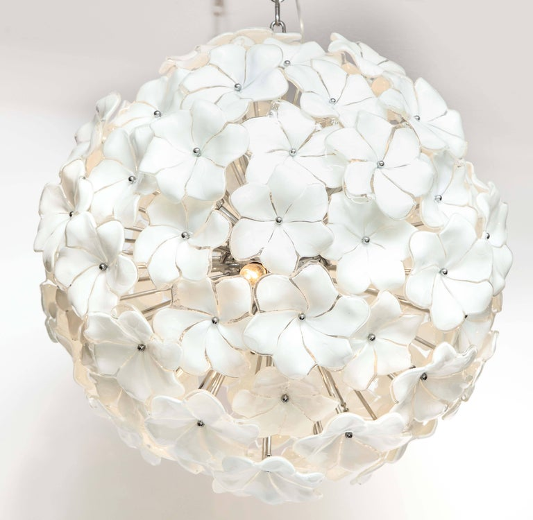 Absolutely beautiful and exquisite in detail. White Murano glass floral sputnik or globe chandelier with individually handcrafted glass petals surrounding a chrome pistil. Polished chrome chain and canopy. Wired for U.S. use with six interior