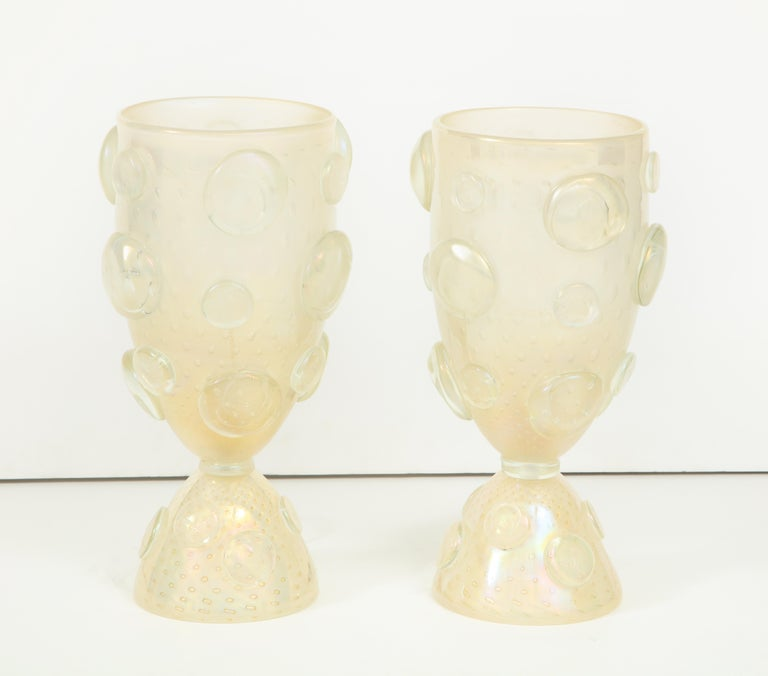 Absolutely elegant! This pair of large vase or urn lamps consist of handblown