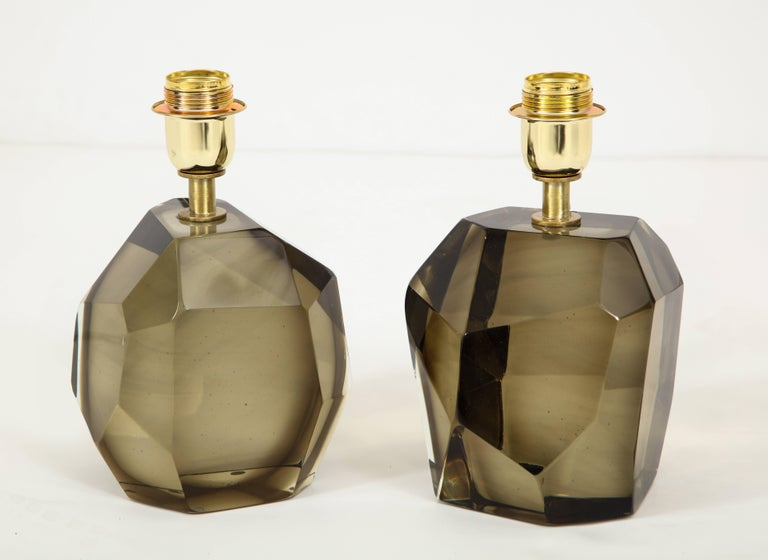 Unique pair of solid faceted Murano glass table lamps in an elegant Smokey taupe or bronze color with a gold tone/brass armature heavy and solid. Made by hand in Murano, Italy. Wired for U.S. use. Height of 10