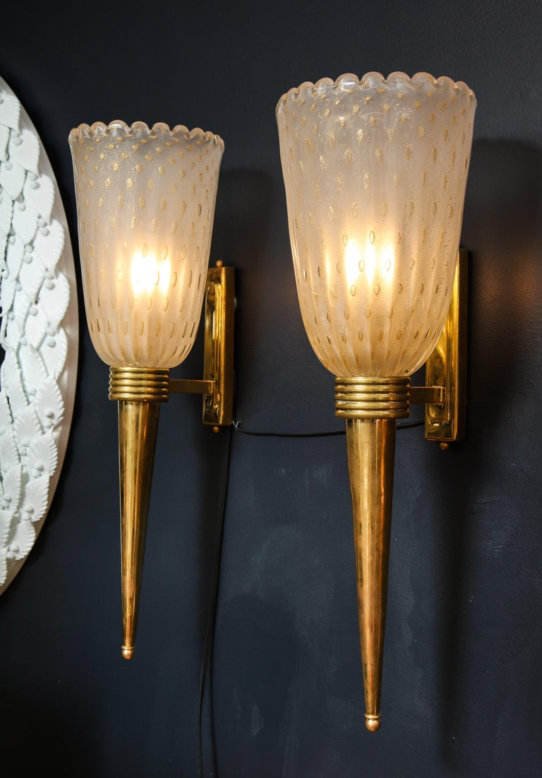 Handblown pair of torch-like sconces consisting of a ivory infused with 24-karat gold flecks.