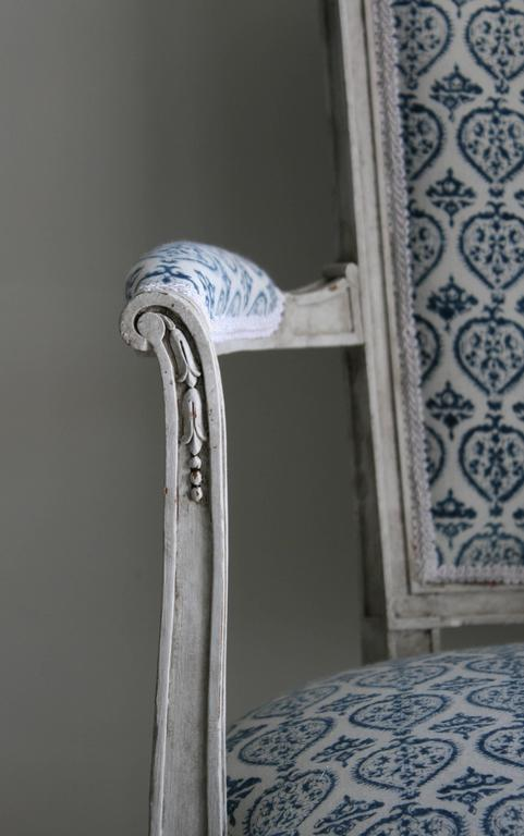 This antique chair is a little gem. Newly upholstered in an organic hand, block-printed French-Indian cotton fabric (indigo against soft white) from Les Indiennes. The antique frame was painted in a soft Swedish grey, with an aged finish that gives