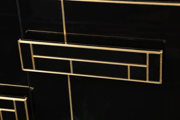 Hand-Crafted One of a Kind Signed Pair of Black Glass and Brass Cabinets For Sale