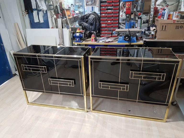 One of a Kind Signed Pair of Black Glass and Brass Cabinets 9