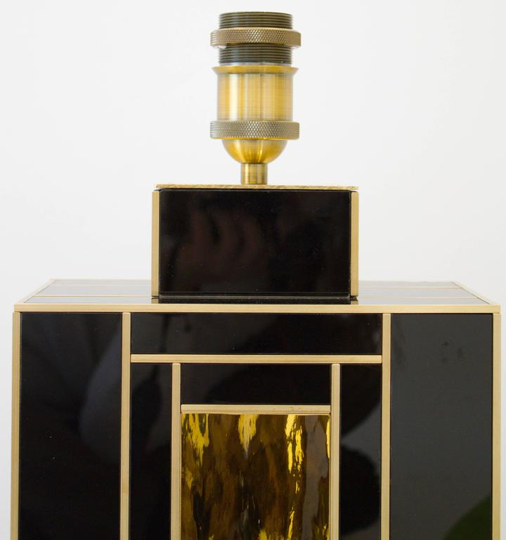 Elegant and unique pair of black glass lamps with imported gold glass insert and brass inlays. Meticulously handcrafted in Spain exclusively for us. An exquisite work of art. Signed by artist/maker. This pair of lamps is on display at the 1stdibs