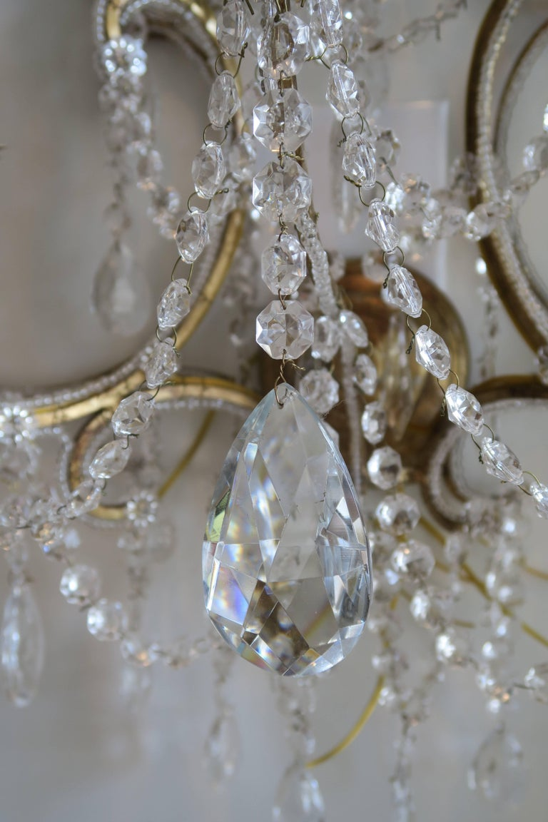 Handcrafted in Italy by a second generation chandelier maker with vintage Murano glass crystals for Disegno Karina Gentinetta. The frames and the sconces are newly constructed out of vintage Murano crystals. Crystals are meticulously hand-knotted