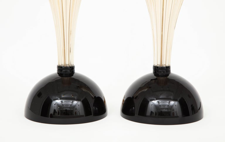 Classic yet edgy! This pair of Italian handblown Murano glass lamps combine timeless classic design with a modern twist. A Clear Murano ridged glass centre is infused with 23 karat gold powder, giving it a shimmering jewelled look which is then