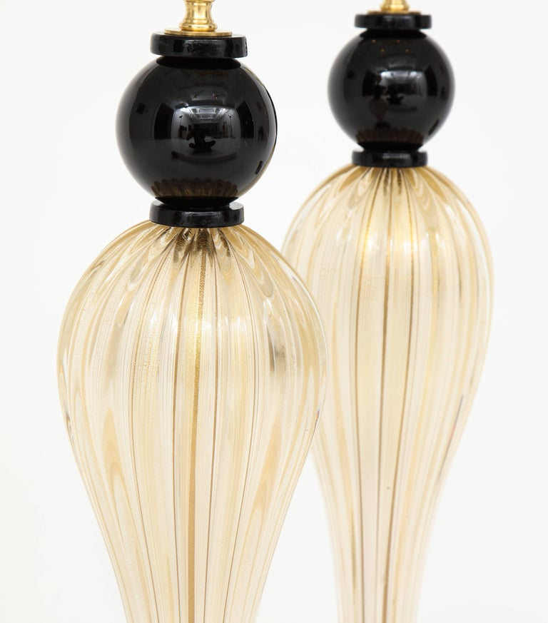 20th Century Pair of Tall Italian Gold and Black Murano Glass Lamps, Signed For Sale