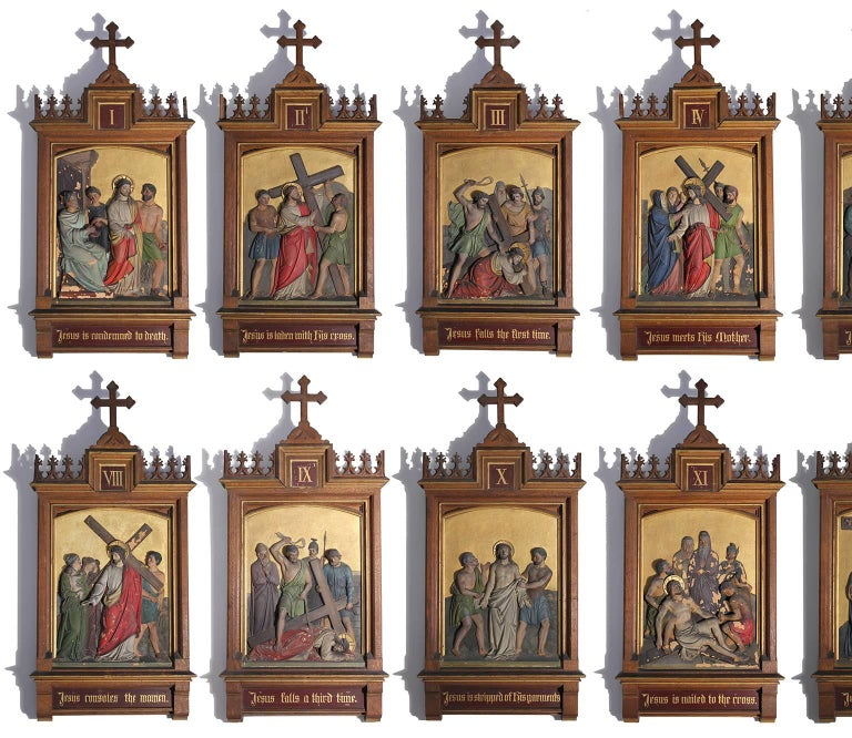 Stunning set of fourteen Gothic Revival Stations of the Cross hand-painted plaster tile paintings incased in beautiful hand-carved elaborate wood frames. Each has wonderful detail and numbered in a Roman numeral. Titles are in English. The stations