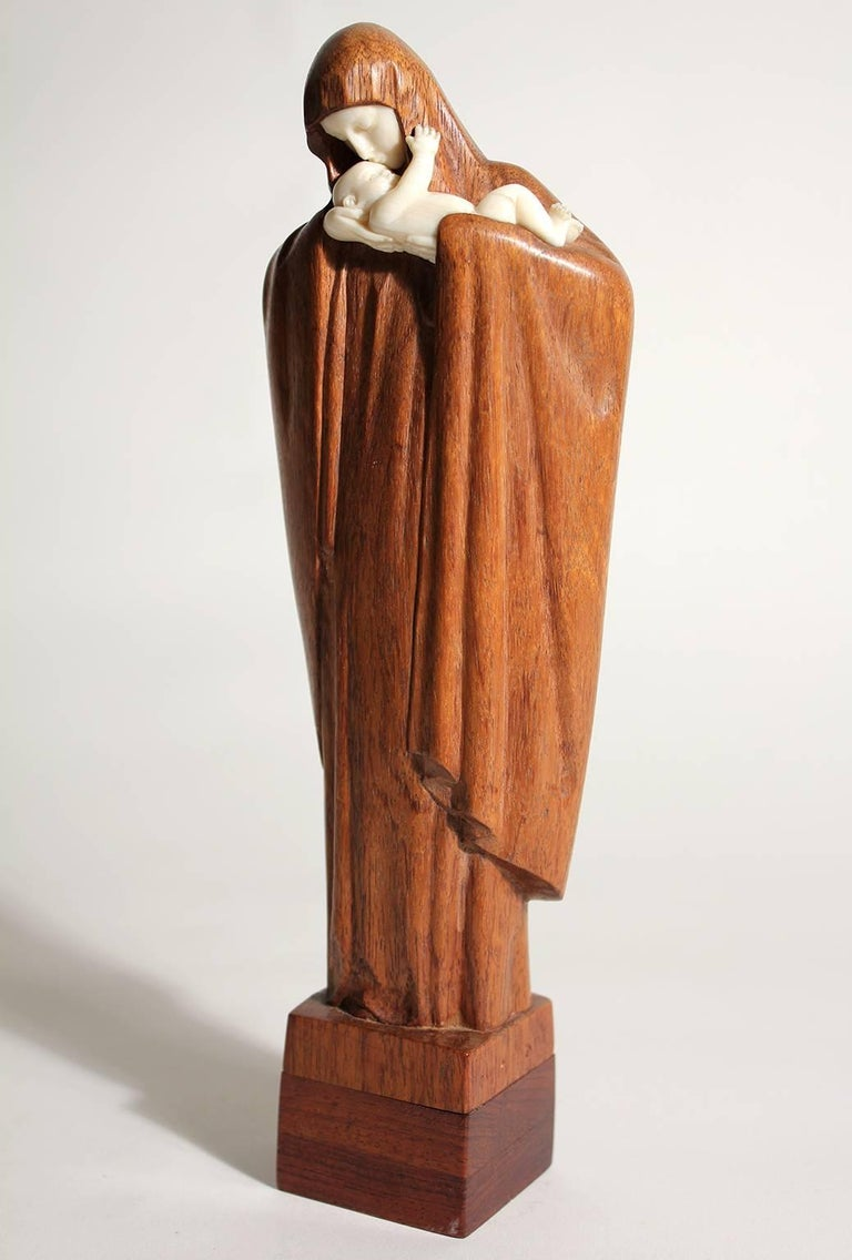 Exquisite French art deco sculpture by listed artist Lucienne Heuvelmans. The sculpture is carved out of wood and chryselephantine. Signed by the artist on the bottom. Excellent quality and detail.