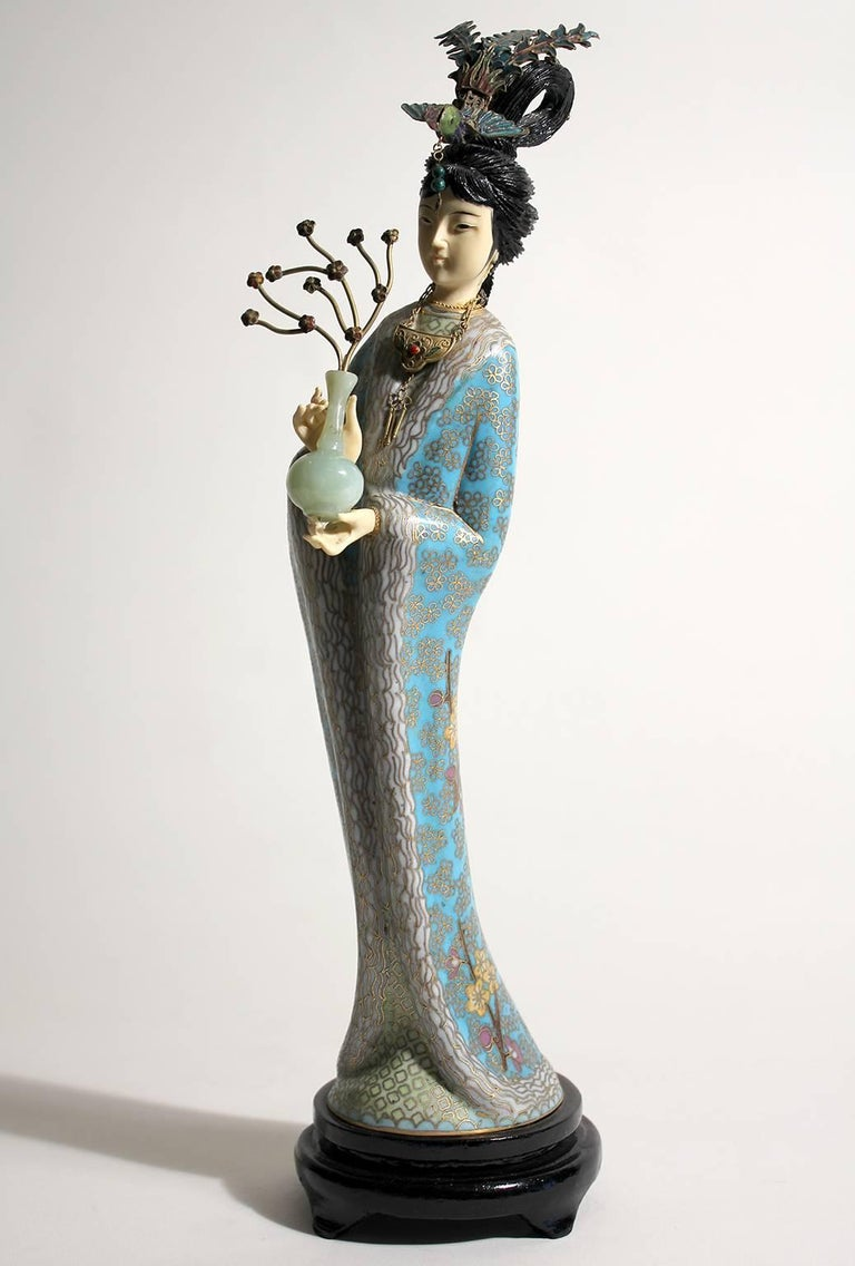 Stunning Chinese Guanyin cloisonné enameled figurine/sculpture. Comes with the original wood stand. Hands and head are carved. Stunning color and details are second to none. Measures: 14