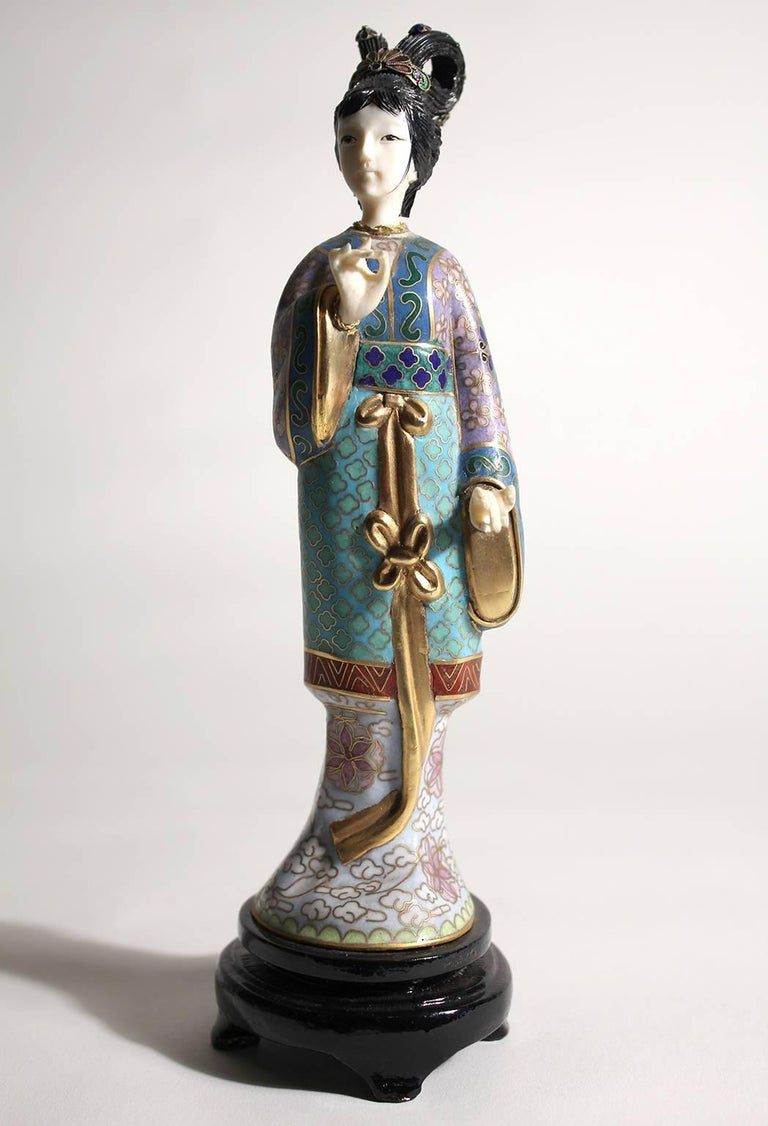 Stunning Chinese Guanyin cloisonné enameled figurine/sculpture. Comes with the original wood stand. Hands and head are carved. Stunning color and details are second to none. Measures 8 1/2