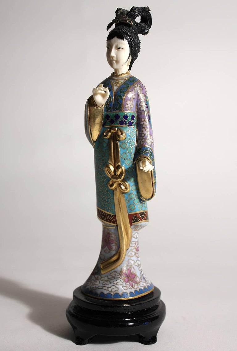 Stunning Chinese Guanyin cloisonné enameled figurine/sculpture. Comes with the original wood stand. Hands and head are carved. Stunning color and details are second to none. Measures: 8 1/2