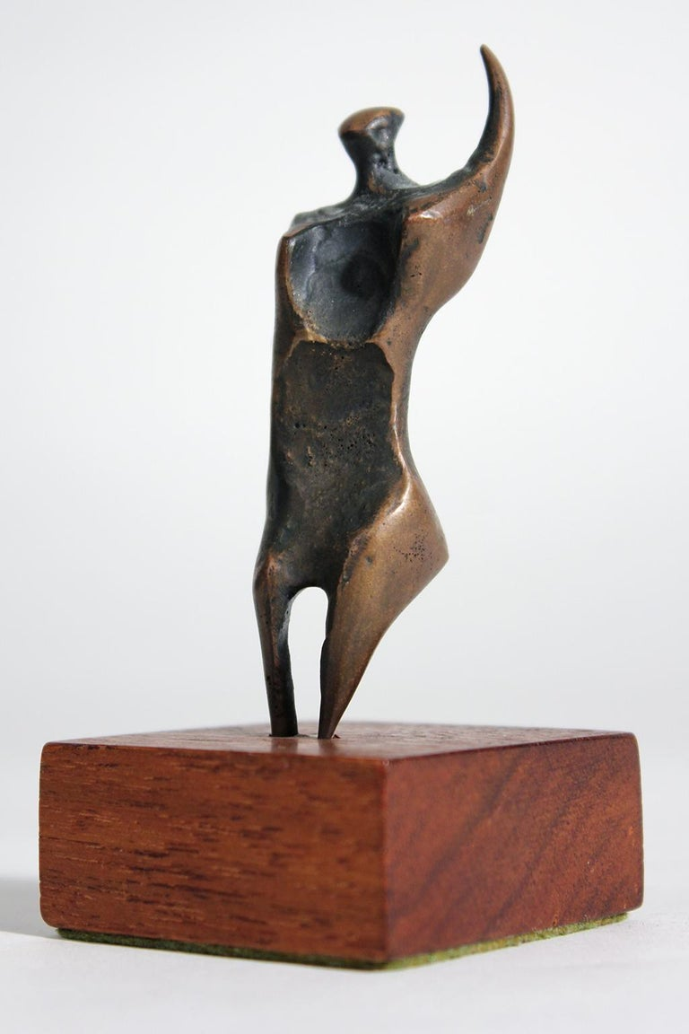 Great Jack Boyd bronze abstract modernist sculpture on original walnut base. Abstract form and a wonderful dark patina. Standing on its original mahogany wood base and is signed on the back as seen in the photos. Measures: 4